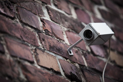 Install some dummy surveillance cameras.