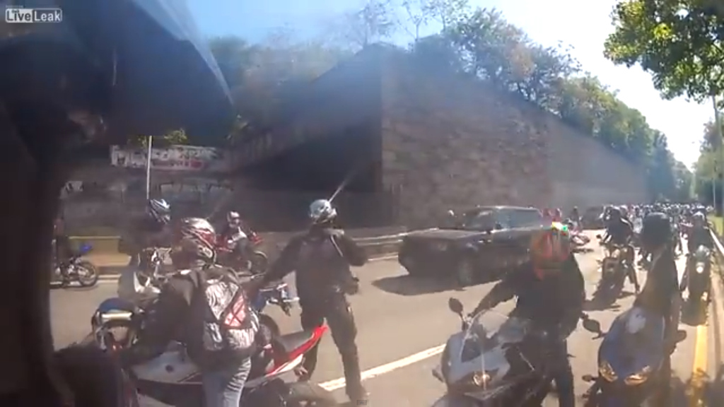Insane Video Of SUV Running Over Bikers, Bikers Then Retaliating By Bashing In SUV's Windows