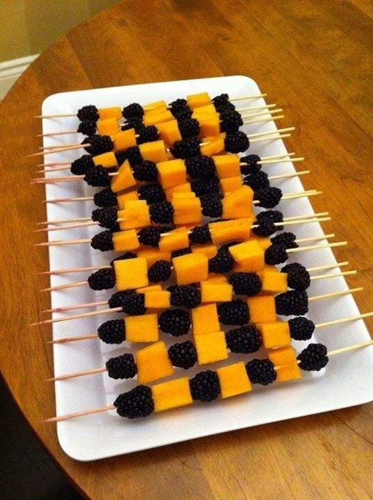 What you'll need:1. Skewers2. Cubed melon3. Blackberries