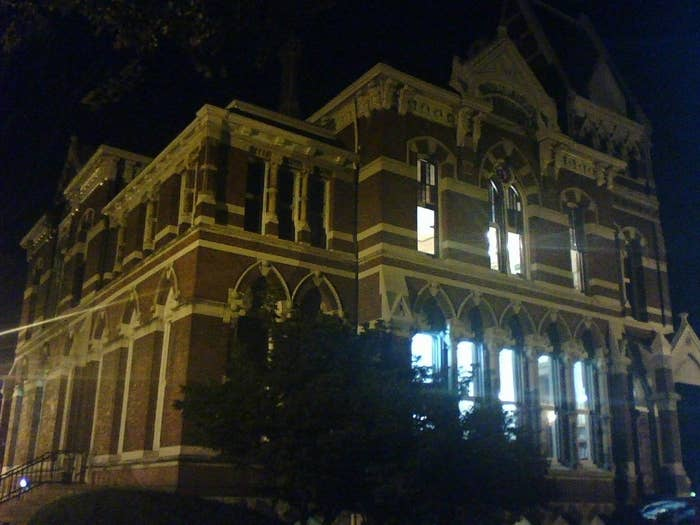 """""""The story of the gray lady began in 1937 when a janitor reported seeing a floating apparition of a woman in the boiler room...Over 1000 sightings have been recorded since 1937; mostly visual in nature. However, according to Maer MacKay of The Willard Library Ghost Chatters, they have also uncovered the existence of the spirit of a male child in the basement children's reading room. The manifestations in this area range from levitating books, to orbs of light, to being touched and having one's hair stroked."""""""