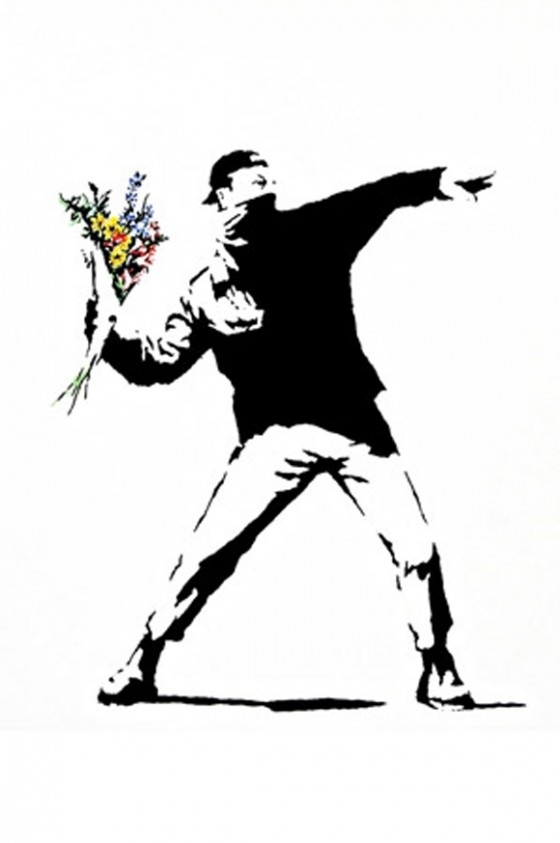 A black top, white bottoms, backward cap, bandana, and a bouquet make you a Banksy piece.