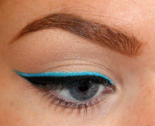 Layer your usual black liner over a neon base.