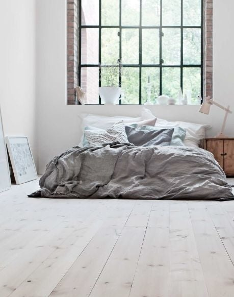 A low bed in a small-ish room gives the illusion of a larger, airier space. All you need is a box spring (which you can find at walmart), a comfy mattress (Ikea has some decent, comfortable ones for cheap) and if you're into extra cloud-like comfort you can add a memory foam.