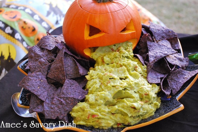 Cool? Eww? I don't know, but it's definitely festive. All you need is a carved pumpkin, some chips, and your favorite guacamole.