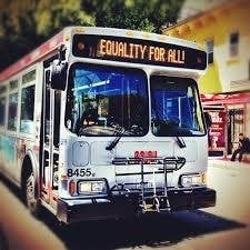 Sometimes a MUNI bus will flash a message where the typical route would be listed. However, MUNI, instead of wishing equality for all, why don't you just try showing up on time so the people can actually get to their equality marches!
