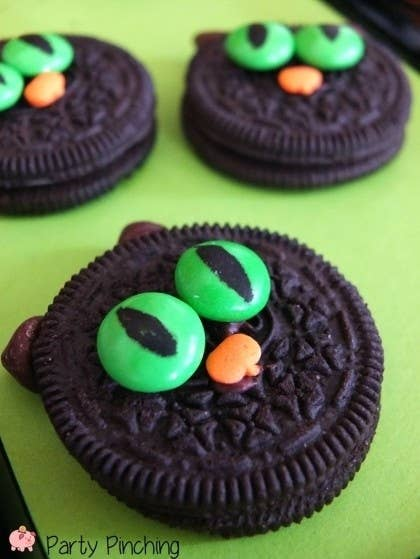 You need: Oreos, green M&Ms, pumpkin sprinkles, edible marker, and chocolate chips.