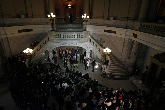 Newark mayor and Senator-elect Cory Booker presides over marriages of nine gay, lesbian, and straight couples in the City Hall rotunda shortly after midnight Monday morning.