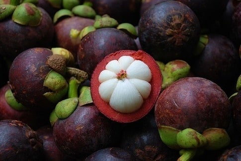 The white, pulpy part of the fruit is what you eat. It is slightly tangy, slightly sweet, and super cool looking.Source: Quora