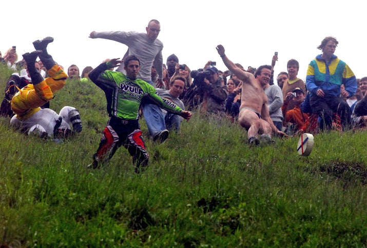When: May 26 (tentative for 2014) Where: Gloucester, England Why you should go: If you've ever wanted to watch hundreds of men run down a hill while chasing a wheel of cheese, then you're in luck — because the Cooper Hill Cheese Roll not only exists, it's quite the romp.