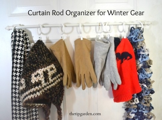 Use a curtain rod to organize winter clothes and accessories.