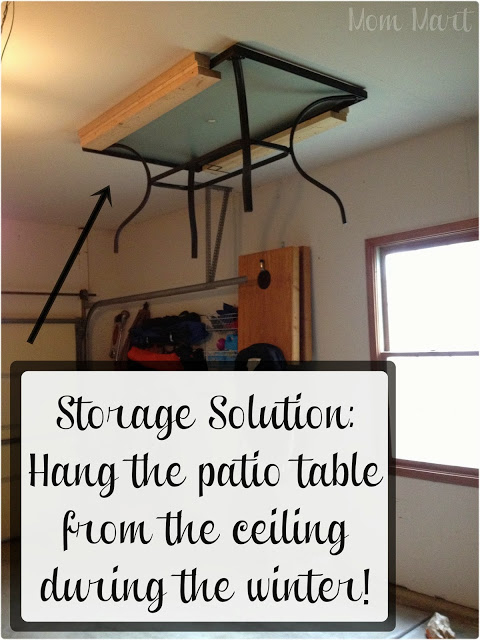 If you're blessed with a patio and a garage, hang outdoor furniture from the ceiling to maximize space.