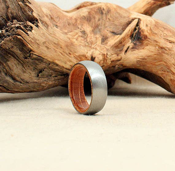 The inner liner of this ring is made from a white oak whiskey barrel. And while the whiskey smell is sealed with finish, you know the goodness is still there. ($245)