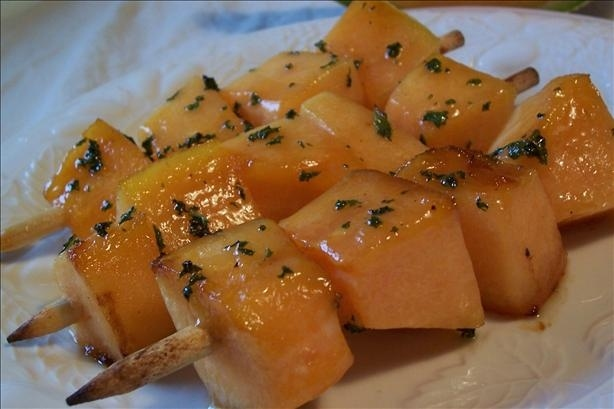 24. Grilled cantaloupe skewers with mint is a refreshing appetizer