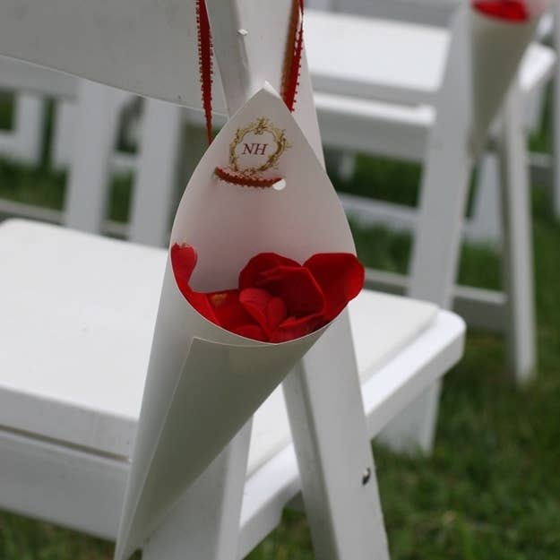 You can also fill them with rose petals and hang them on chairs.