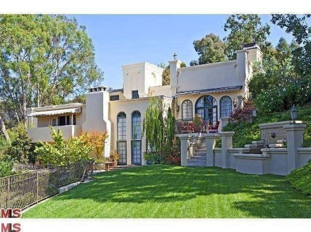 """Josh Groban has been willing to slide down the scale on the price of his Malibu retreat. After first listing the 6,138-square-foot vacation home for $6.1 million back in 2010, the singer then dropped the price to $5.95 million and continued to try and find a buyer in 2011.With 2014 on the horizon, the curly-haired crooner is making another attempt to move on from the property that InStyle magazine called an """"instant vacation."""" Groban has relisted the Tuscan-style property for $5.475 million. Malibu median home values are at $2.028 million and rising, so it's pretty certain Groban will get his ask. Set on 2 hilly acres, the gated and private home contains 4 bedrooms and 4.5 bathrooms. There's a separate guesthouse with an additional bedroom. If Groban finds a buyer this time around, he'll still have a crash pad when he's in Hollywood as he also owns a Beverly Hills condo.Using Zillow's mortgage calculator, a monthly payment on Groban's Malibu retreat would be $21,332, based on a 20 percent down payment on a 30-year fixed mortgage."""