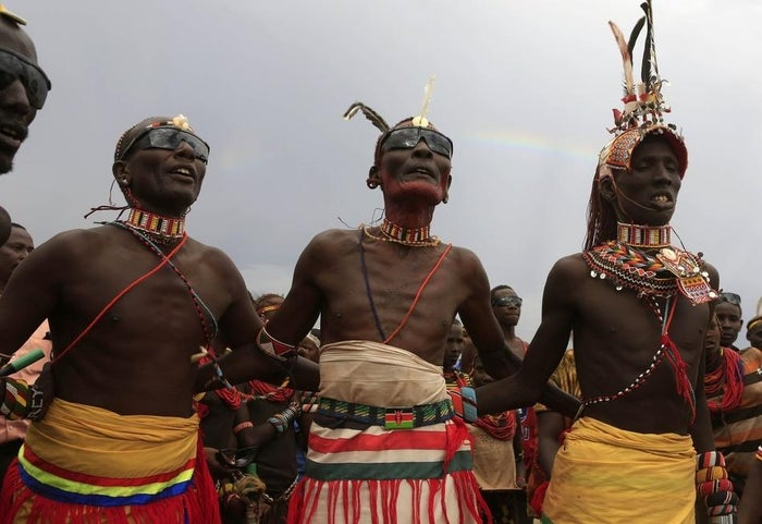 Turkana men dance and sing during the hybrid solar eclipse at the remote Sibiloi National Park. Local myths in northern Kenya attribute the event to the Moon eating the Sun.