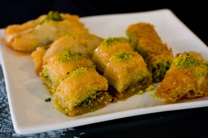 What is it: Layers of phyllo dough filled with chopped walnuts or pistachios, cinnamon and sugar covered in honey syrup. Why you'll love it: Baklava oozes deliciousness in every bite. It is the ultimate sweet food for any sugar lover. Recipe here.