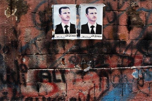Photos of Syria's Bashar al-Assad in a pro-Hezbollah neighborhood in Beirut.