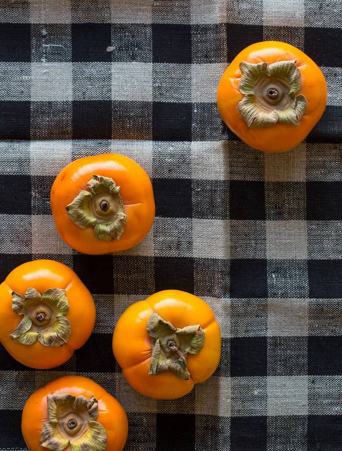 'Tis the season for persimmon picking. There are two main varieties of persimmons commercially sold in the U.S. Acorn-shaped Hachiya Persimmons are tart and chalky until ripe, while tomato-shaped Fuyu Persimmons are sweeter and can be eaten firm. The more you know.