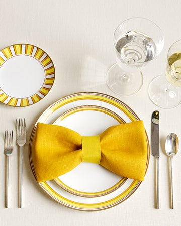 Just fold the napkins into a rectangle and cinch the center with a matching (or contrasting) ribbon.