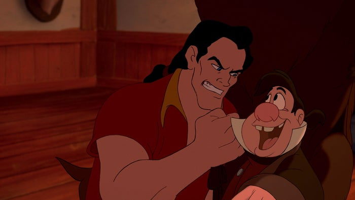 Choked, beaten, throttled, thrown, humiliated -- LeFou suffers repeatedly at the hands of Gaston in every scene in which he appears.QUESTION: Is LeFou a masochist, or merely addicted to physical torture?It doesn't appear as if he's getting paid money to endure the never-ending crap heaped upon him, so we can deduce that LeFou is a willing lacky -- a remora fish stuck to the shark's side. And while, clearly, being Number One Toadie to the most popular jock in town probably has residual benefits (free beer? desperate women?) it doesn't seem like it would be worth the physical abuse to any normal person. Yet, for every eye-bulging head punch, LeFou bounces back grinning. While it may be that LeFou is simply infatuated with Gaston to an unhealthy degree, after the sheer amount of physical punishment we witness, we're forced to conclude that on some level, LeFou might be getting off on it.