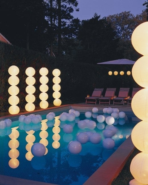 Creating cool lighting for your venue of choice can be an expensive endeavor. Try this DIY that involves stacking paper lanterns on a dowel to make giant light columns.