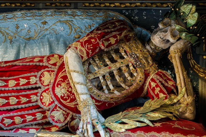 """One of the finest decorated skeletons in Switzerland, he has been present in the church since the 17th century, but is now hidden behind a painted cover."""