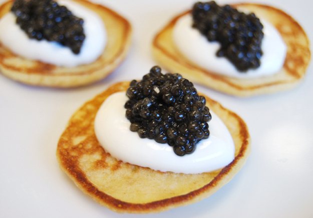 Since it's just you two, try a fancy-schmancy appetizer like caviar blinis. These are a bitch to make for a crowd.