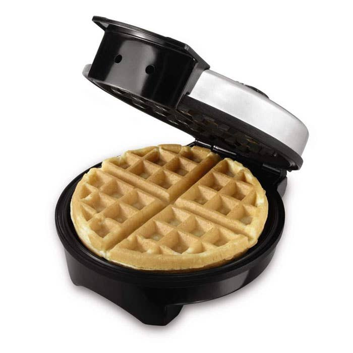 This waffle iron has a 5-setting browning control, a nonstick cook plate, and a two year warranty. Britney has none of these things.