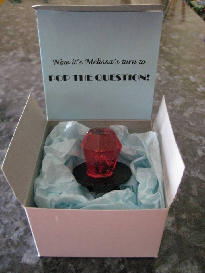 A ring pop in a box is an easy, adorable way to pop the question to your bridesmaids.