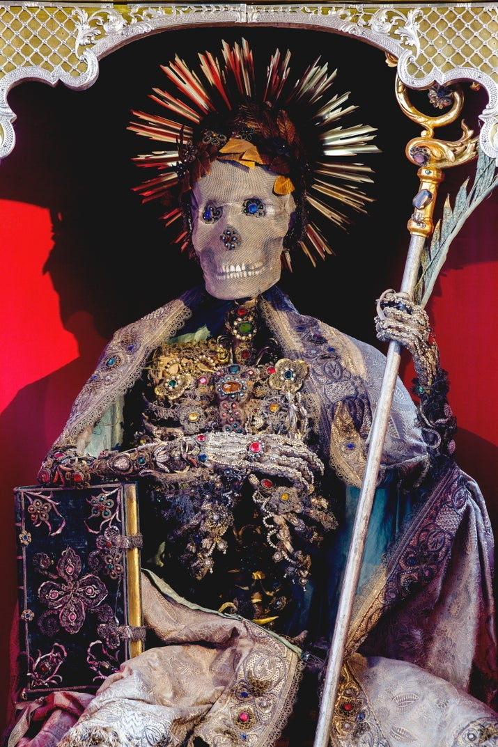 """He is the only one in this group that was not believed to be an Early Christian martyr. A medieval abbot of the town's monastery, he was so famed that when the fad for decorating skeletons became popularized, his bones were exhumed and decorated in the same style in order to give him prominence."""