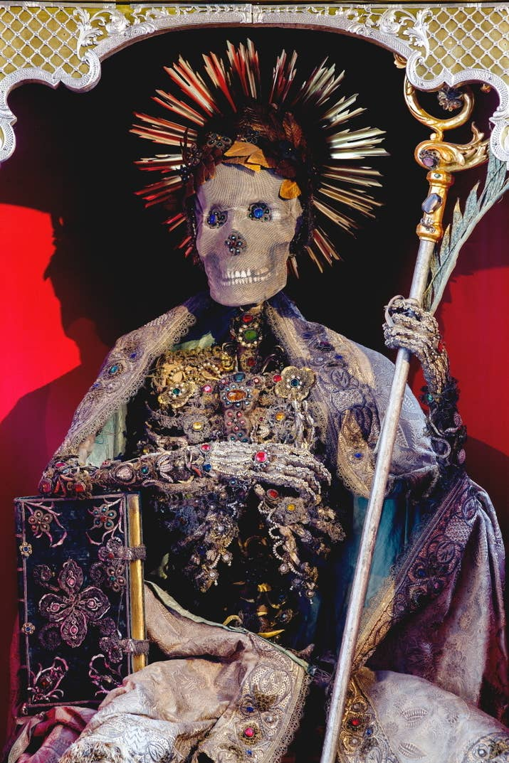"""""""He is the only one in this group that was not believed to be an Early Christian martyr. A medieval abbot of the town's monastery, he was so famed that when the fad for decorating skeletons became popularized, his bones were exhumed and decorated in the same style in order to give him prominence."""""""