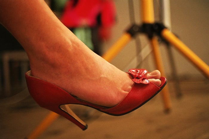 In one Christmas custom to determine whether or not young women will be married in the coming year, they throw a shoe over their shoulders towards the door. If it lands with the toe pointing towards the door, she'll soon be married.