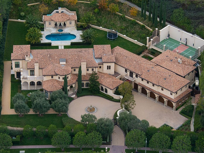 "Barry Bonds, whose all-time MLB home-run record has been tainted by his apparent use of performance-enhancing drugs, can't get the votes to put him in the National Baseball Hall of Fame. He's also having some problems selling his Los Angeles-area mansion.Now the surly slugger has taken steps to accelerate the sale: He's dropped the price from its original list price of $25 million to $23.5 million. Bonds had been quietly shopping the home at 44 Beverly Park Circle in Beverly Park for the past year, but it has now entered the multiple-listing service.After moving from the Pittsburgh Pirates to the San Francisco Giants, the perennial All-Star and MVP bought the estate in 2002. While Bonds has trimmed down from his bulked-up playing physique, thanks in part to his new love of bicycle riding, his estate remains huge. At a massive 17,000 square feet, Bonds' Italian-style mansion sits on a 1.85-acre lot. Among the home's features: A 12-person theater, ""commercial-grade"" gym and a full spa, which includes ""steam sauna and tanning salon … a hydrotherapy tub and Swedish full-body therapy rooms.""Outside there isn't a baseball diamond, but a 2,100-square-foot sports court, pool and loggia with outdoor kitchen. A two-story guesthouse rounds out the rest of the grounds.Beverly Glen, where Bonds' home is located, is a high-priced 'hood, with median home values of $1.789 million, but Bonds' home stands out. Most homes on the market there are well under $20 million."
