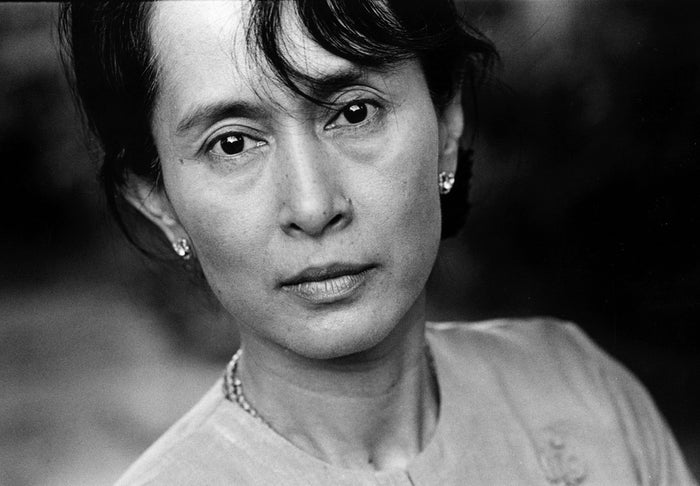 Who is she?: Burmese opposition leaderHow does she run the world?: Between 1989 and 2010, she spent 15 years under house arrest, being held as a political prisoner by the military government due to her revolutionary activities. Her National League for Democracy party took 59% of votes and 81% of parliament seats in the 1990 election but the government refused to concede power. She received numerous awards while in detention, including the 1991 Nobel Peace Prize. She was released from detention for real in 2010, was elected to parliament in 2012 and is currently fighting for the right to run for President in 2015 (the current constitution, adopted in 2008, bans widows and mothers of foreigners from office. Her late husband was English, as are her children.)