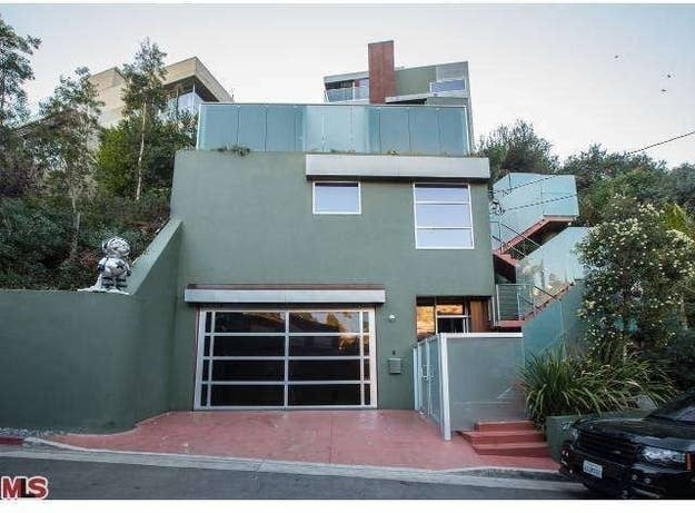 """Chris Brown has dumped and been dumped when it comes to the dating game, but this time, the embattled singer is dumping his modern home in Hollywood Hills. He has it listed for $1.92 million.The 3-bedroom, 3-bathroom abode is one of at least two Los Angeles-area homes where Brown's fast cars, graffiti art and parties made him unpopular with the neighbors. The president of the Hollywood Dell Civic Association once told the L.A. Times that Brown's graffiti tags were devilishly frightening – and bad for property values. Hollywood Hills home values currently hit at a median of $1,371,800. With the house at 2738 Rinconia Dr, Los Angeles, CA 90068 on the market, all signs of Brown's boisterous tenure are gone. No cars, no more graffiti, no more Rihanna sightings – probably because Brown's ex has listed her own L.A.-area home for rent and made a move to New York City.Brown's home spans 3,000 square feet and is suited for entertaining. There's an elevator, custom LED lighting, high ceilings, walls of glass and """"exotic stones."""" The house also includes a saltwater pool, spa and sand pit as well as an outdoor patio with fire pits, stone waterfalls and a projection screen.Brown is also trying to unload his home in West Hollywood. The condo is currently listed for $1.695 million, down from the original list price of $1.895 million back in May 2012."""
