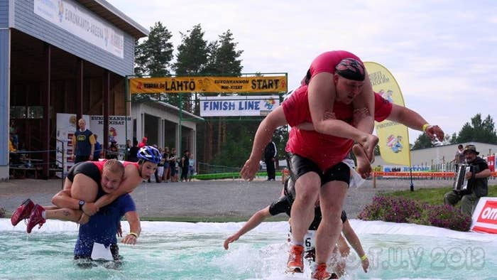 Finns engaged in wife carrying, one of the local sports.