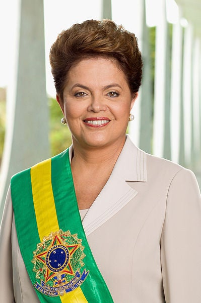 Who is she?: President of BrazilHow does she run the world?: She grew up in an upper-middle class family and became a socialist in her youth, eventually joining various urban guerrilla groups fighting the military dictatorship in the 1960s. She was jailed and reportedly tortured between 1970 and 1972. She slowly worked her way up through the world of Brazilian politics, working as Minister of Energy from 2002 until a corruption scandal in 2005 resulted in her taking over the position of Chief of Staff. She was elected President in late 2010, as the result of support from many high profile figures both inside and out of Brazil. Due to her Bulgarian heritage, there was also a media frenzy in that country surrounding her election. She is now leading the country through one of its most exciting and turbulent periods, as it prepares fro the FIFA World Cup and 2016 Summer Olympics.