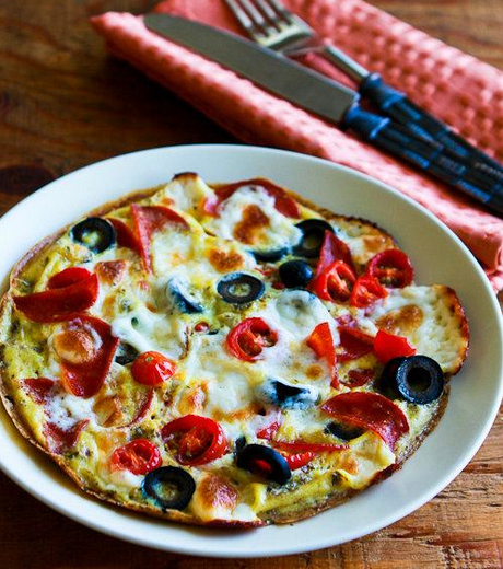 Egg-Crust Breakfast Pizza with Pepperoni, Olives, Mozzarella, and Tomatoes