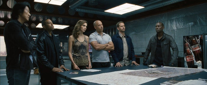 Here she is standing next to Vin Diesel in Fast & Furious 6.