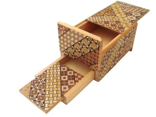 Because after you've unwrapped a present, you want to spend hours trying to navigate a wooden box.