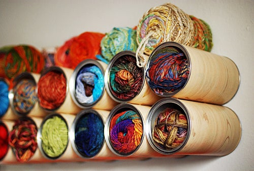 For the crafters: As the stash grows the eternal question remains - just where is all of this stuff going to go?! Put your pretty yarns (or even fabrics and notions) on display by giving them their own upcycled coffee can cubby.