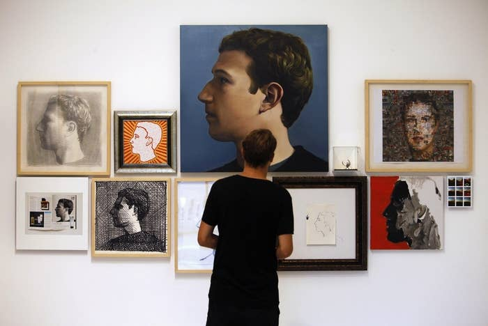 A visitor looks at portraits of Facebook's founder Mark Zuckerberg at solo exhibition The Face of Facebook by Chinese artist Zhu Jia at a gallery in Singapore, Oct. 30, 2013.