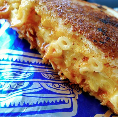 That's right, a grilled cheese sandwich with mac and cheese stuffed inside. While there are several ways to make this sandwich, here's one recipe.