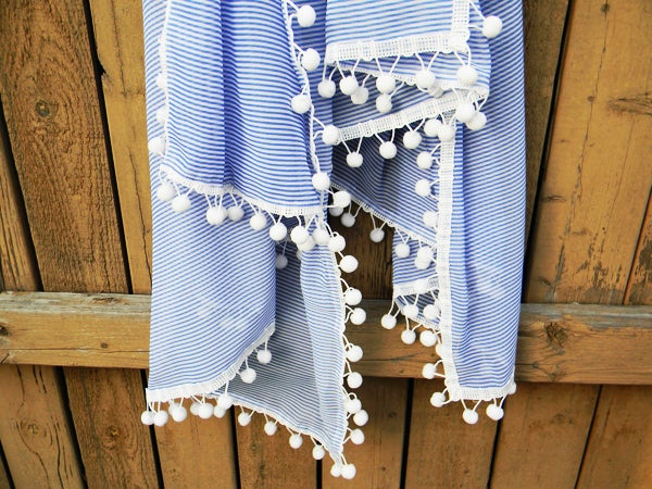 Got some leftover fabric? Glue a bit of pom pom trim to the edges, wrap it up in some fancy tissue paper and give it to your little sister like you just spent a week's worth of groceries on that baby at Anthropologie.