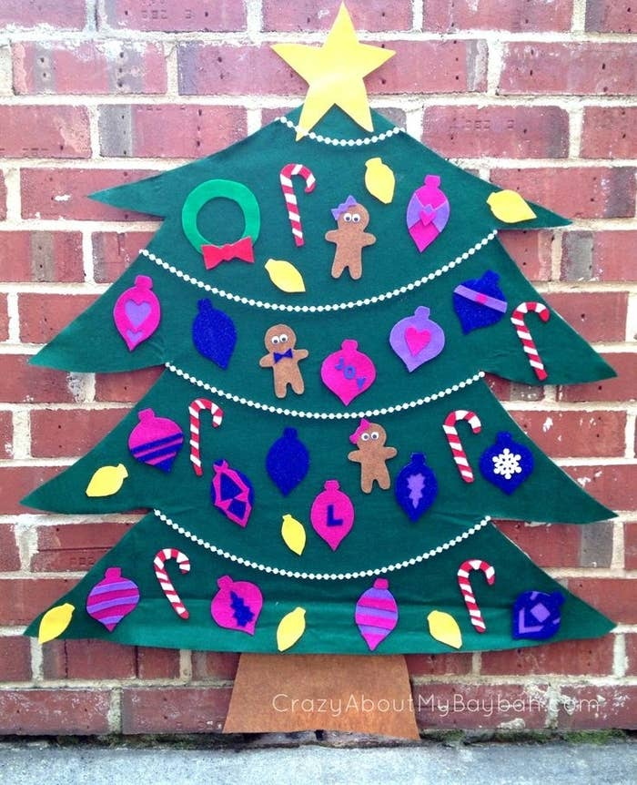 "Little kids who are too small to hang ornaments on the family tree will love ""hanging"" ornaments on this felt tree. Find the how-to here."