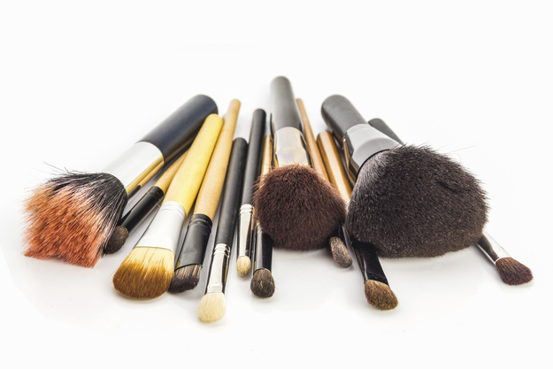 Using dirty makeup brushes.