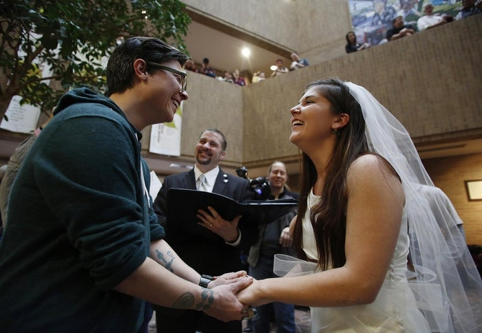 Jax Collins (left) and Heather Collins get married at the Salt Lake County Government Building in Salt Lake City, Utah, Dec. 23, 2013.