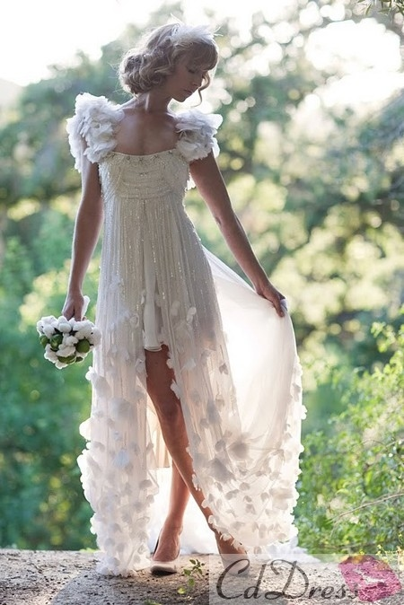 The way a dress can be long and elegant while showing just a sliver of leg.