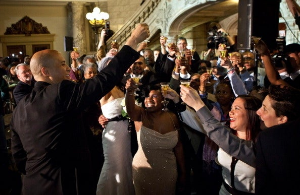 Then-Newark Mayor Cory Booker (left) celebrates the first night of marriage equality in New Jersey on Oct. 21, 2013.